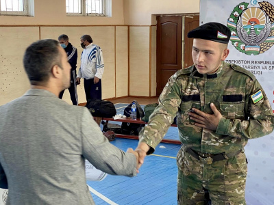 Participants of the Uzbekistan Mas-Wrestling Championship greet friends around the world